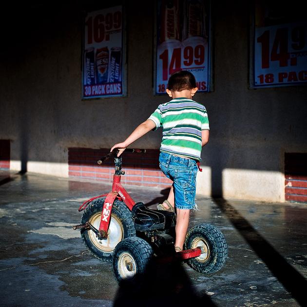 Boy on Trike – Niland, California – 2012